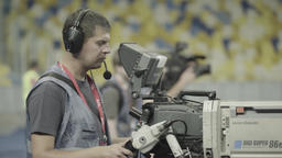 A professional cameraman with a camera during a TV broadcast at the stadium Footage