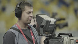 TV broadcast: Cameraman during a TV broadcast at the stadium Footage