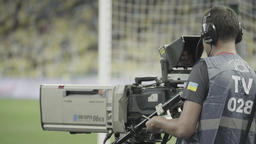 TV air. TV broadcast. Cameraman with a TV camera in the stadium Footage