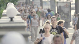 People walk down the street during the day. Crowd. Crowded street Footage
