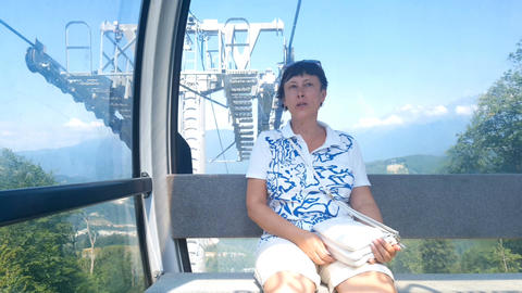 Woman in the cabin on the cable car. Rosa Khutor. Russia Footage