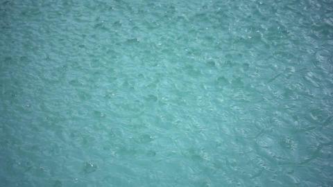 Rain Drops Splashing In Puddle Footage