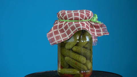 Rotating handmade potted pickled cucumbers in glass jar Footage