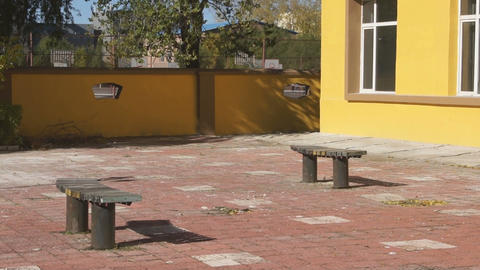 Yellow building corner (panning up) Stock Video Footage
