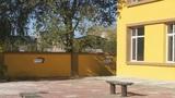 Yellow building corner (panning up) Footage