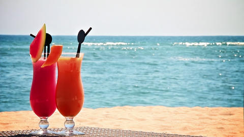 Two cocktails on the beach Stock Video Footage