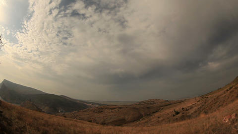 Cloudy sky over the mountains and the sea. Balaklava,... Stock Video Footage