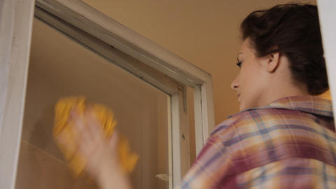 Woman cleaning window Stock Video Footage