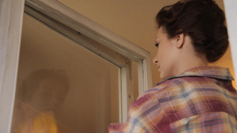 Woman cleaning window sequence Stock Video Footage