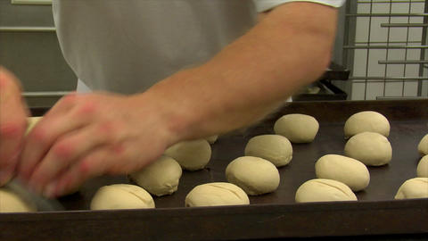 10727 german bakery roll dough cut into dolly Stock Video Footage