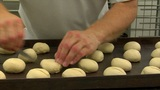 10727 german bakery roll dough cut into dolly Footage