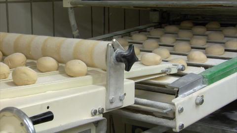 10728 roll bun on conveyor belt dolly wide Stock Video Footage