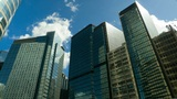 Skyscrapers over blue sky, timelapse Footage