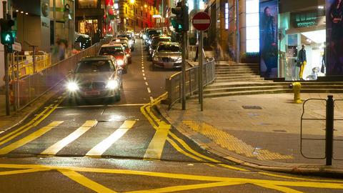Street traffic in Hong Kong at night, timelapse Stock Video Footage