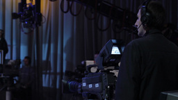Cameraman working in a TV Studio. Behind-the-scenes work of live broadcast Footage