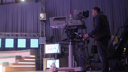 Cameraman with a camera in the TV Studio Footage