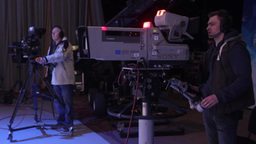 The cameraman in TV Studio during the recording of the ether Footage