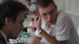 Two guys students communicate during their studies Footage