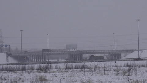 Machine on viaduct. Winter road Footage