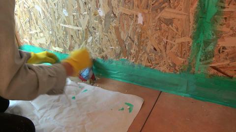Worker fixing waterproofing tape on bathroom construction Footage