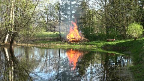 Beautiful bonfire campfire on lake coast Footage