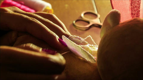 Closeup Woman Hands Sew Embroider Butterfly Wings at Table Footage