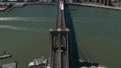 Aerial american flag on brooklyn bridge ビデオ
