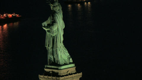 Aerial view circling behind statue of liberty Live Action