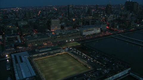 Stadium aerial into heavy nyc traffic Live Action