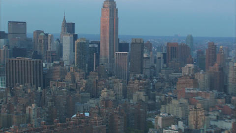 Aerial evening zoom from empire state building to city Footage