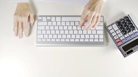Woman worker working on computer and wireless mouse in the office Image