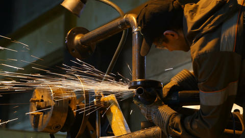 Closeup Worker Cuts Pipe with Tool in Heavy Industry Plant Footage