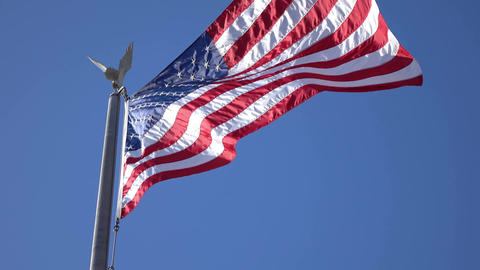 Video of United States flag waving in the wind in 4K Footage