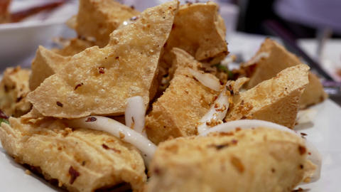 Pan shot of deep fried spicy tofu with steam inside Chinese restaurant 4k resolu Footage
