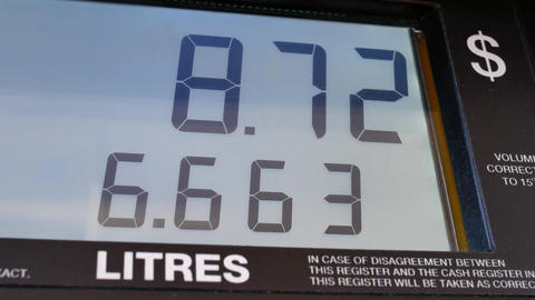 Big screen of rising gas prices on pump screen Live Action