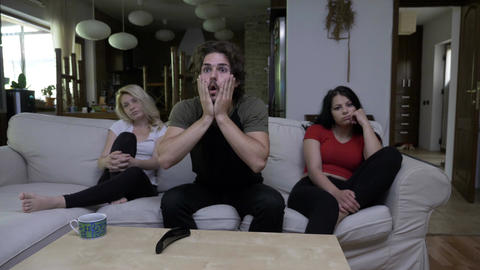 Friends watch movie together and the guy is very passionate amazed surprised but Footage