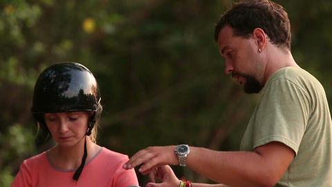 Girl in Helmet Consults Instructor how to Control Scooter Footage
