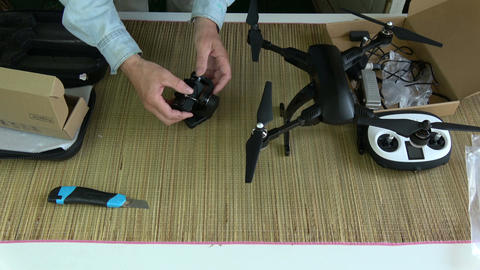 Videographer fixing new foldable drone camera on gimbal Footage