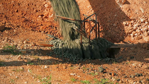 Cinemagraph of Concrete poured into a pit in the ground from concrete mixer Footage