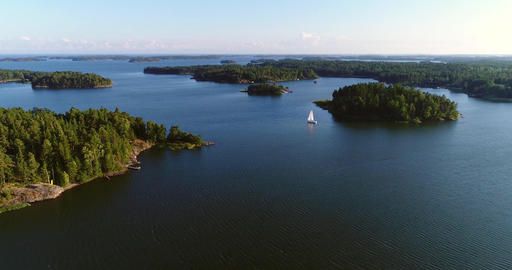Sailboat in archipelago, Cinema 4k aerial view towards a sail boat, in uusimaa Footage