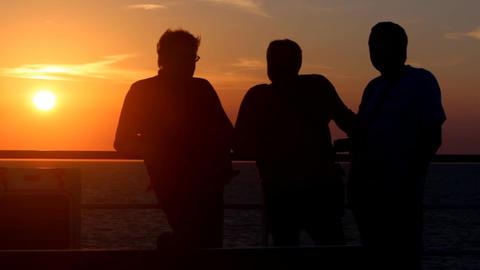 friendly communication at sunset Image