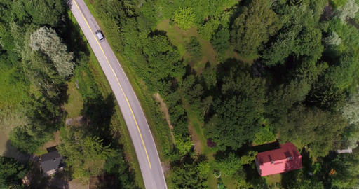 Cars on island road, Cinema 4k aerial view of cars driving on a asphalt road in Footage
