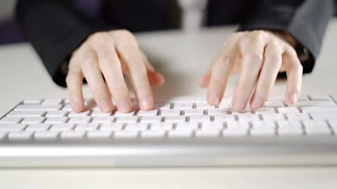 Hands business female typing on keyboard computer in the office close up ビデオ