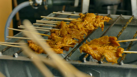 4K Dolly grilling pork satay Footage