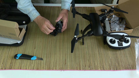 photographer testing new drone gimbal with action camera Live Action