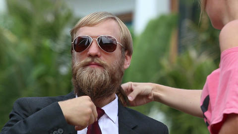 Girl Assistant Brushes Guitarists Beard and Corrects Tie Footage