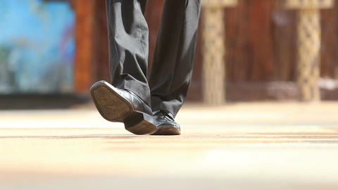 man in black shoes steps to focus and comes backward Footage