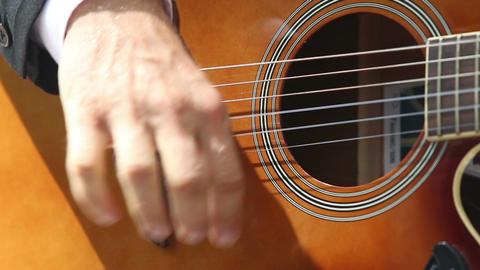 man plays guitar by beat of strings Footage