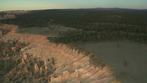 Aerial shot of bryce canyon national park over green forest Footage