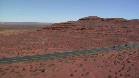 Aerial shot of three motorcycles on monument valley highway ライブ動画